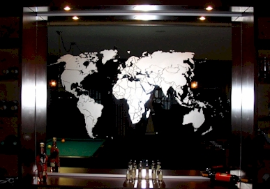 sandblasted image of world map on a mirror / copyright © Vision2form